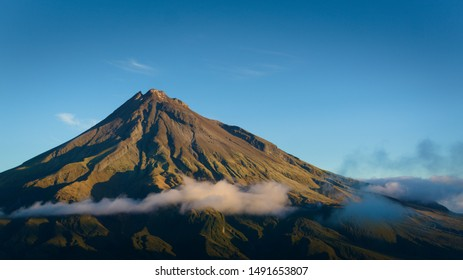Mount Taranaki, New Plymouth in New Zealand. Mount Taranki during sunset; hike to great views on the volcano. Panoramic view on New Zealands´ strativolcano.