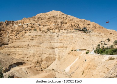 Mount of Temptation in Jericho, West Bank with the Monastery of the Temptation embedded in the rock.