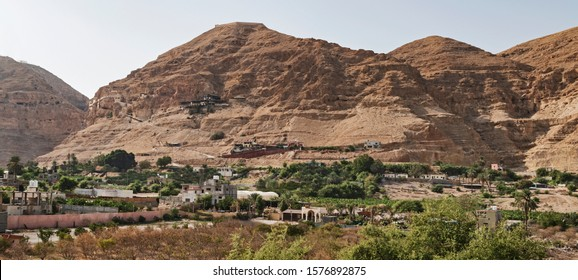 the mount of the temptation of jesus in jericho Palestine showing the monastery and the cable car dock on the side of the limestone cliffs