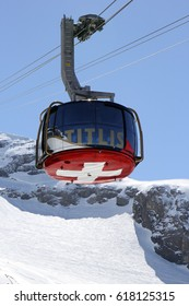 MOUNT TITLIS, SWITZERLAND - APRIL 09, 2017: Rotair Gondola with Swiss cross sign on the Titlis mountain, Engelberg, Switzerland