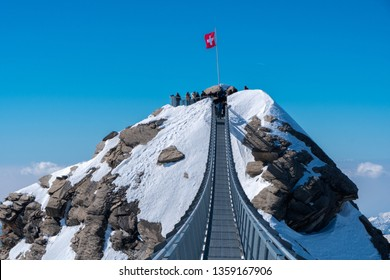 Mount Titlis, Switzerland-March 27,2019:The Titlis Cliff Walk  is a pedestrian bridge along the cliff of Mount Titlis in the Swiss Alps. Built at around 10,000 feet (3,000 m) above sea level.