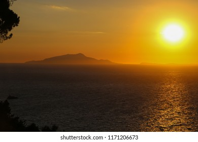 Mount  Vesuvius in golden light at sunset in the Gulf of Naples in Italy, Europe