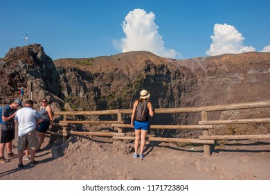 MOUNT VESUVIUS, ITALY - AUGUST 1, 2018: Tourists walk around the crater of Mount Vesuvius.