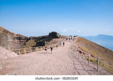 Mount Vesuvius, Italy - August 30, 2016: Tourists walk around the crater of Mount Vesuvius, one of the most dangerous volcanoes in the world.