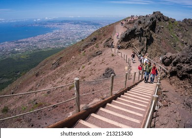 Mount Vesuvius, Italy, May 11, 2014. Tourists on the edge of the crater of Mount Vesuvius.