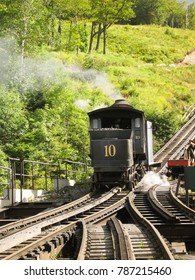 Mount Washington, New Hampshire -September 2008: A steam engine departs the base station for the summit on the cog railway