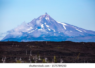 Mount Washington and a river of lava from the summit of McHenzie Pass Oregon