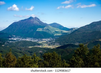 Mount Yuhudake and Yuhu city area under blue sky in Oita