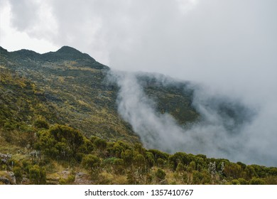 A mountain  against a foggy landscape in the Aberdare Ranges on the flanks of Mount Kenya, Kenya