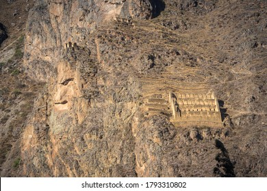 Mountain with ancient inca ruins at Ollantaytambo city, in Sacred Valley of Cusco, Peru. Known as The Giant, because of its shape which looks like a big hunchback man with a face in profile.