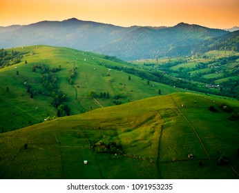 Mountain area with fences and sheds from Bucovina, a region in northern ROMANIA.