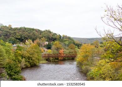 mountain autumn landscape metal train bridge flowing river
