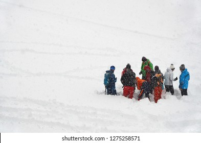 mountain avalanche rescue searching in snow