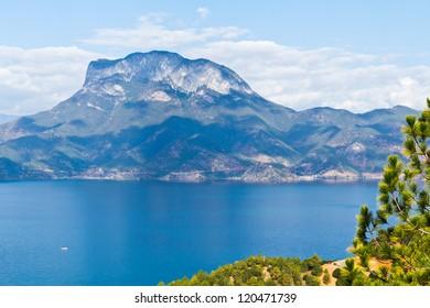 A mountain beside a blue lake