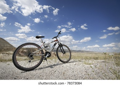 Mountain bicycle and cloudy blue sky