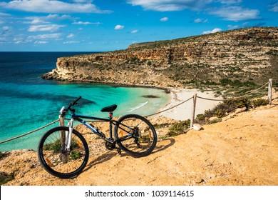 Mountain bike by the sea, Rabbit beach, Lampedusa, Sicily