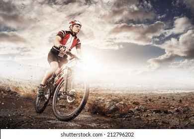 Mountain Bike cyclist riding single track above sunset valley