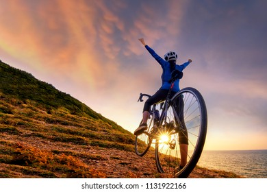 Mountain Bike cyclist standing on top of a mountain with bicycle .Extreme sport concept.