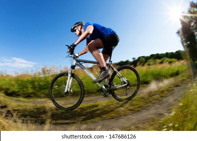 Mountain bike downhill on country road