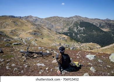 mountain bike girl relaxes on top of  Prokletije Mountains in kosovo
