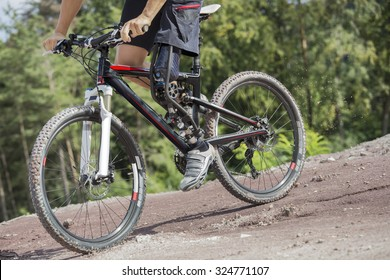 Mountain bike rider with leg prosthesis. Unfiltered version.