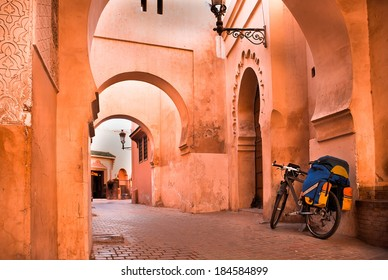mountain bike standing near a red wall in the Muslim city of Marrakech in the street with beautiful arches and walls, ornamented tiles.