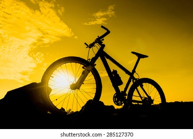 mountain bike with sunset silhouette