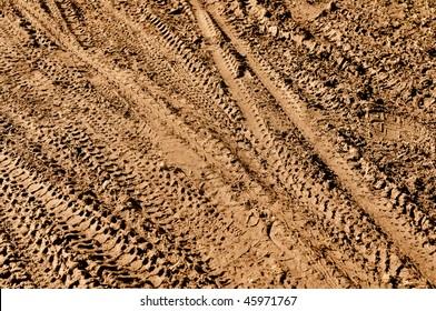 Mountain Bike Tracks in Mud Background