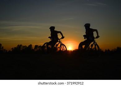 mountain bike ,twilight,  people,  action,