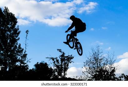 Mountain biker jumps through the air
