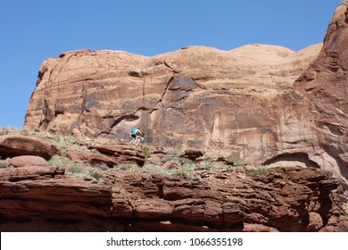 Mountain biker on the Cliffhanger off road bike trail in Moab Utah.  Empty space for text, quote, or saying on sky background.