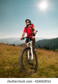 mountain biker on a meadow, enjoying his ride