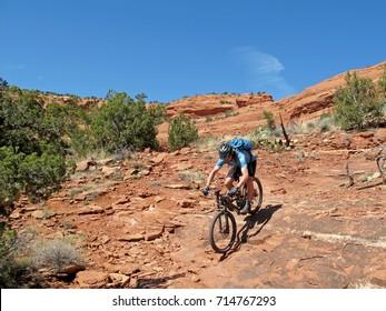Mountain biker in the red rocks, Sedona, Arizona, USA