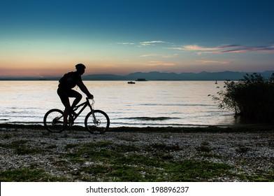 mountain biker riding on Lake Garda in Italy