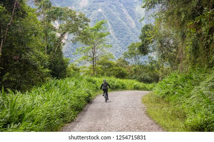 mountain biker Yungas Road, also known as 'Death Road' due to its notoriously high death rate, was cut into the side of the Cordillera Oriental Mountain chain in the 1930s