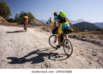 Mountain bikers are travelling in the highlands of Tusheti region, Georgia