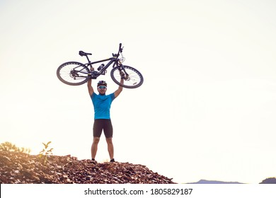 Mountain bikes cyclist cycling, silhouette Asian man athlete top of bike on rocky terrain trail, extreme sport wearing gear uniform, exciting freedom outdoor sunset nature healthy active lifestyle