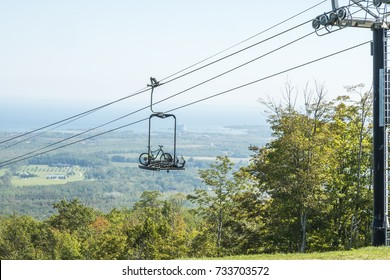 Mountain bikes travel up a lift to the trail head at the top of Blue Mountain in Collingwood Ontario Canada.
