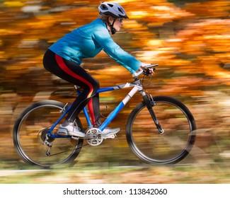 Mountain biking down the trail