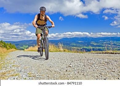 Mountain biking in summer mountains