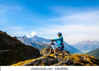 Mountain biking - woman on bike, Dolomites, Italy