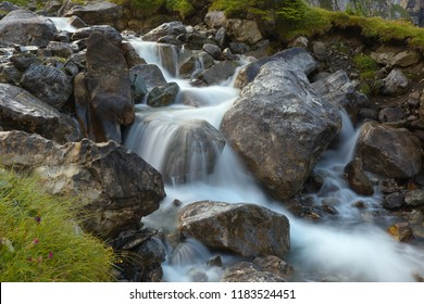 Mountain brook with flowing water on the stones, long exposition