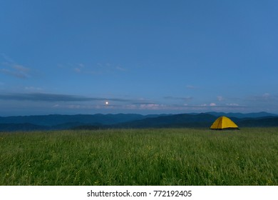 mountain camping and moonrise