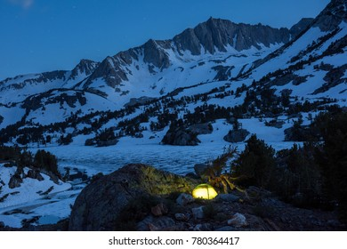 Mountain Camping in a Snowy Scene