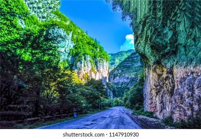 Mountain canyon road landscape in Abkhazia. Mountain road in Abkhazia canyon. Mountain asphalt canyon rock view