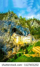 Mountain castle rock in Slovenia. Castle in Postojna cave in Slovenia. Predjama castle in Slovenia