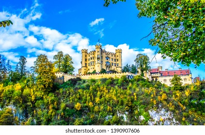 Mountain castle through forest trees view. Castle in mountains. Mountain hill castle view. Mountain castle landscape
