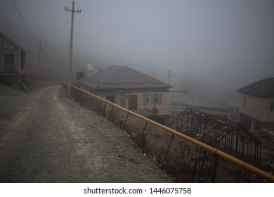 Mountain Caucasian village in the fog