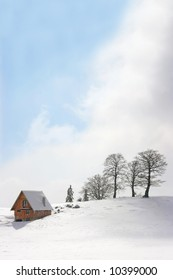 mountain chalet in winter, square frame