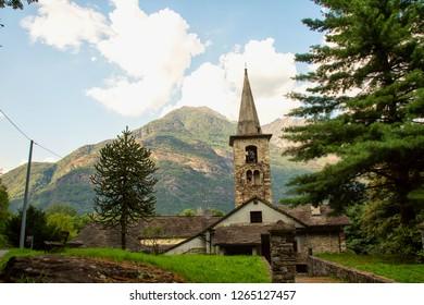 Mountain church under blue cloudy sky, horizontal image